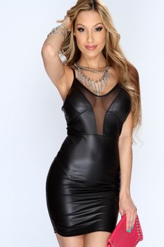Strike a pose with this over the top sexy look! Youll have all eyes on you wherever you go! Be the life of the party and add this amazing dress to your collection! Youll sure get compliments wherever you go! It features faux leather, mesh cut outs, v neck, light padded, spaghetti straps, and tight fitted. 96% Polyester 4% Spandex. Made in USA.