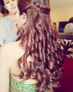 Hairstyles for Engagement - Loose curls with a Braid on Head | WedMeGood #wedmegood #indianbride #indianwedding #curls #braid #hairstyle #hairstyleforengagement