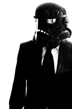 This is extremely cool in my mind and i like how everything is in a black and white format especially how the helmet should be white but instead it's black to match the suit and tie. what I'm trying to say really is that he looks super bad ass. #Gentleman #follow http://www.pinterest.com/armaann1/classy-mofos/ | Men's fashion | Style |