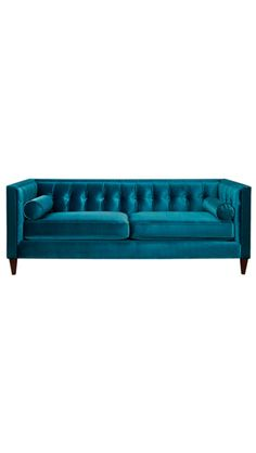 Love this deep turquoise sofa