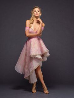 712bfd947e6c3 Style Reznor Pompadour Pink off-the-shoulder gown, textural warped  embroidery and asymmetrical skirt.