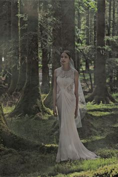 Cypress Gown from BHLDN - Love this gown! The vine-inspired beadwork is absolutely gorgeous, and it would be perfect for an outdoor wedding! This photo captures exactly how I imagine our wedding day. Natural and ethereal!