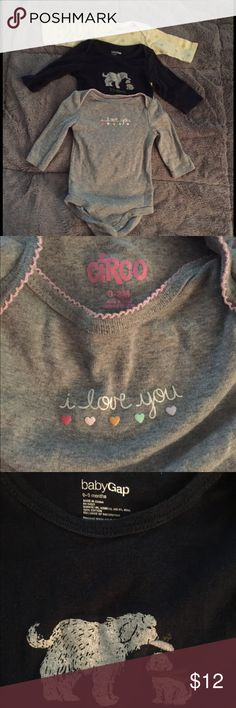 """Long sleeve onesie bundle Three good condition long sleeve onesies all 0-3 month size. One grey with pink """"I love you"""" from circo, one navy blue with puppies that says """"I love mommy"""" from gap, and one yellow with teddy bears from gerber. Circo, Gerber, Gap Shirts & Tops"""