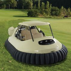 "The Golf Cart Hovercraft - This is the golf cart that glides over sand traps and water hazards on a cushion of air as easily as it does over fairways and the rough. Powered by a 65-hp twin-cylinder Hirth engine, its nine-blade axial-flow ducted fan propels the craft up to 45 mph and 9"" off the ground without harming grass, allowing immediate crossing of a pond or stream to follow-up a cross-water shot. Choses Amusantes, Motorcycle Style, Engin, Hammacher Schlemmer, Golf Carts, Golf Trolley, Jaguar, Take My Money, Cool Cars"