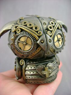 Steampunk Owl. Things like this can be made with polymer clay and gears/findings. I use metal finishes. JGP
