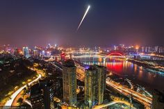 As the Moon rose and the Sun set on October 8, 2014, a lunar eclipse was in progress seen from Chongqing, China. Trailing through this composite time exposure, the rising Moon began as a dark reddened disk in total eclipse near the eastern horizon.