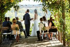 Intimate symbolic ceremony under an arch overlooking the Tuscany hills www.originaltuscanwedding.com