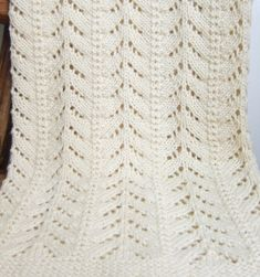 """Free Knitting Pattern for 6 Row Repeat Petit Pins Baby Blanket - This """"Little Pines"""" blanket features a 6 row repeat lace pattern. Rated easy by Ravelrers. 30″ x 32″. Aran weight yarn. Available in English and French. Designed by Espace Tricot to match the Norwegian Fir baby cardigan pattern by OGE Knitwear Designs."""