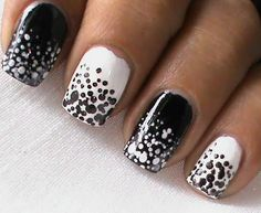 These black and white snowfall nails are so easy to do. Just get out your dotting tools and start spotting away.
