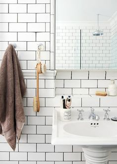Bathroom,white subway tiles     The Sydney home of Leanne Carter-Taylor and Trent Carter-Brugman via the Design Files.