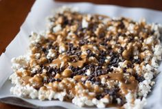 Toffee Popcorn with Chocolate from All She Cooks brings a new spin to toffee popcorn with a classic candy favorite. Chocolate makes this tasty treat even tastier.