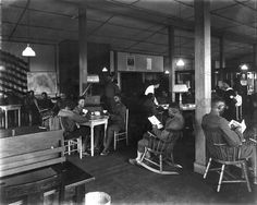 """YMCA reading room for the segregated soldiers of color at Camp Sherman, WWI. This reading room had newspapers from major cities all over the country so soldiers could get the news from """"back home,"""" magazines, and books."""