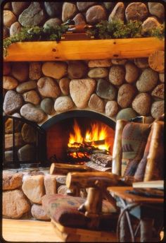A river rock fireplace. Does it get any better than that? Cabin cliche at its most welcome!