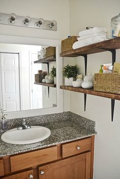 DIY framed bathroom mirrors - THE EASY WAY!! See how to frame your bathroom mirrors to make your bathrooms look amazing & it's so simple! A ...
