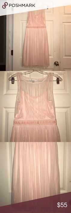 LC Lauren Conrad Blush Pink Tulle Dress XS Blush pink Tulle dress. Midi. Sleeveless. Lined. Zipper closure. Size XS. 100% polyester. Measured across: shoulder to shoulder 11.5in, armpit to armpit 16in, waist 12.5in, length 38in LC Lauren Conrad Dresses Midi