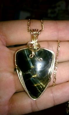Blue Tiger Eye necklace in gold wire wrap • See more of his stunning jewelry collection on Facebook • Armando Jr Designs