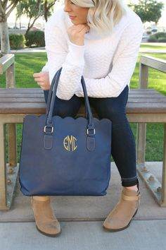 """These designer inspired scalloped handbags have just the right amount of style and simplicity. High quality faux leather with scalloped top edge. Black faux suede interior on all colors. Double handles with open top design; gold hardware. No interior pockets. Stitched with your choice of monogram or single letter in our favorite fonts. Bag itself measures 14"""" wide x 13"""" tall x 5"""", not including handles.Available in 7 heavenly hues: black, navy, luggage brown, mint, winter white, fuchsia…"""
