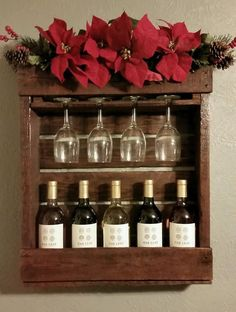 The wine rack is 2 ft tall by 1 ft wide and can hold up to 5 wine bottles. The wine rack has 4 inserts to hang wine glasses and has a built in shelf at the top for decorations. Rustic Wine Racks, Wine Bottles, Shelf, Decorations, Canning, Glasses, Cool Stuff, Mini, Top