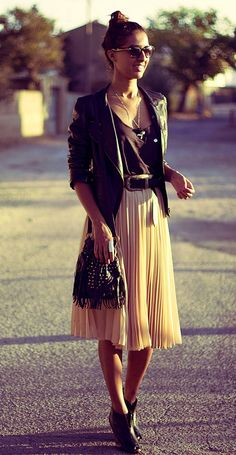 Black Leather Jacket and Black Tee add some Edge to a Pleated Skirt
