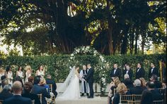 Rebecca and Gerard's Wedding at the Coral Gables Country Club. Flowers by Avant Gardens Miami
