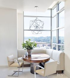 A geometric brushed-nickel pendant hovers in this breakfast room.