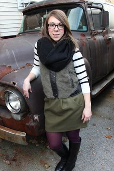olive green skirt with eggplant tights. black cowl