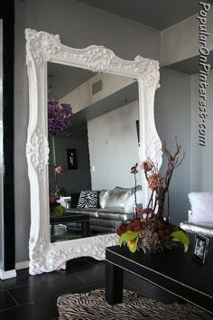 wow wow wow. I would love this giant mirror in my living room or even dining room