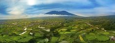 Mount Merapai and Bukit Tinggi http://www.brucelevick.com/mount-merapai-bukit-tinggi/ One of my favourite features of the DJI Mavic Pro is the ability to switch the camera to portrait mode and capture in RAW bracketed photos to process and turn out images such as this one looking over the valley of Bukit Tinggi in West Sumatra. VIEW THE FULL SIZE HERE  #Aerial, #Beautifulworld, #Bracket, #BukitTinggi, #Bukittinggi, #Dji, #Drone, #HDR, #Indonesia, #Mavic, #Panorama, #Pro, #