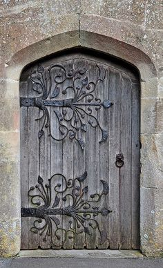 Age-old door: Wrought iron & wood in stone