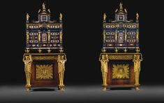 A pair of Italian Pietre Dure mounted, inlaid ebony cabinets, Roman, circa 1625, on a pair of Regency rosewood and parcel-gilt stands possibly to a design by C H Tatham, first quarter 19th century