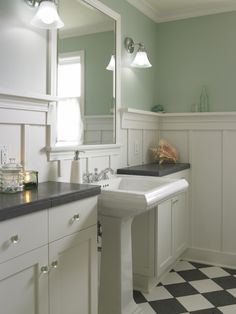 I love everything about this bathroom.  Simple and clean.  The black and white tiles.  sea foam green.