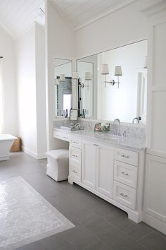 Sconces: Visual Comfort Bryant Sconces in polished nickel on mirrors.  Mirrors are custom by local glass company.