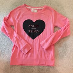 Victoria's Secret Angel pink sweatshirt small Literally like brand-new only worn once beautiful soft sweatshirt by Victoria's  secret pink and black size small Victoria's Secret Tops Sweatshirts & Hoodies