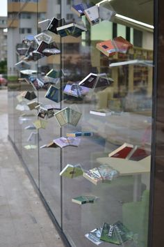 Romanian storefront . . dramatic effect using books, a saw and a powerful adhesive. Love it.
