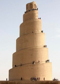 "The spiral minaret of the Great Mosque of Samarra (also known as the Malwiya Minaret) in Samarra, Iraq. The word ""malwiya"" translates as ""twisted"" or ""snail shell"". The minaret is approximately 171 feet (52m or roughly 17 stories) tall."