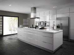 Dark grey floor, dark grey work surface and pale grey shiny cupboards