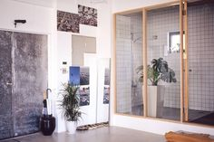 Love this tropical plant in the wet room.  Minimalist Industrial Tokyo Loft - emmas designblogg
