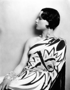 """A well dressed woman, even though her purse is painfully empty, can conquer the world.""  Louise Brooks"
