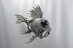 Ptolemy Elrington, an artist from Brighton, England, uses old hubcaps to make sculptures of creatures like fish, birds and other animals