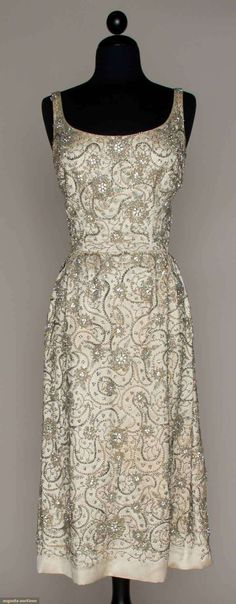 Jewel encrusted evening dress, late 1950s. Property of singer Maria Ellington Cole/Mrs. Nat King Cole, worn while attending an opening of her husband's: white silk satin covered in silver sequins, irridescent crystal beads, rhinestones & pearl ropes.
