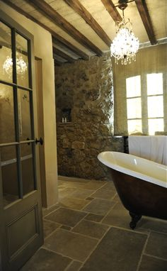 Heated stone floors + deep tub Love the tile. Tuscan Bathroom, Rustic Bathrooms, Modern Bathroom, Bathroom Interior, Stone Bathroom, Design Bathroom, Master Bathroom, Rustic Luxe, Rustic Elegance