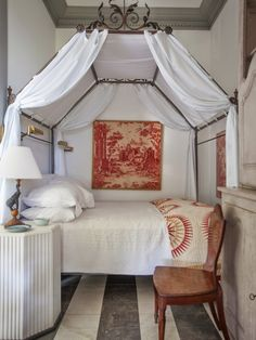 Small Bedroom With a Canopy Bed If this space were our guest bedroom for a weekend, we might never leave. With an iron canopy bed, sophisticated toile, and classic antique furniture, it's the epitome of European elegance. Home Bedroom, Master Bedroom, Bedroom Decor, Bedroom Ideas, Bedroom Inspiration, Dream Bedroom, Bedroom Setup, Bed Ideas, Decor Ideas
