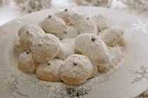 I made these for the Middle School Teachers today and they came out great, but be careful they are fragile!!  Kourabiethes - Greek Shortbread Cookies with Confectioner's Sugar and Almonds
