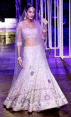Lisa Haydon walked the ramp in an elegant light pastel pink Tarun Tahiliani's embroidered lehenga choli at India Bridal Fashion Week 2013 #Bollywood #Fashion