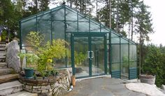 BC Greenhouses Builders | This greenhouse was designed to fit over a rocky landscape! Beautiful!