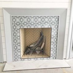 Most Popular Fireplace Tiles Ideas for Your Fireplace Surround - Stylish Tile Options for Your Fireplace Surround. Naxos, a white marble from Greece, is a great fit for glamorous fireplace surrounds. Fireplace Hearth Tiles, Herringbone Fireplace, Fireplace Redo, Fireplace Remodel, Fireplace Surrounds, Fireplace Design, Fireplace Ideas, Paint Fireplace Tile, 1930s Fireplace