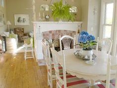 Love the white table and chairs...