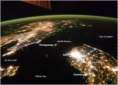 A NASA image released Feb 2014 shows a photo taken by the Expedition 38 crew aboard the International Space Station of the Korean Peninsula at night. North Korea in the middle is almost completely dark compared with neighboring South Korea. Nasa Photos, Nasa Images, China North Korea, South Korea, Space Photos, Space Images, Station Iss, Space Station, Earth At Night