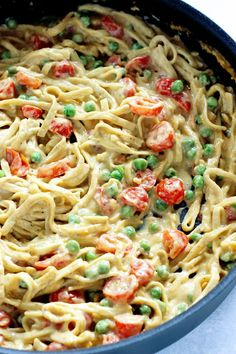 One Pot Vegan Fettuccine Alfredo with Peas and Roasted Cherry Tomatoes - Creamy healthy deliciousness all in one pot. http://NeuroticMommy.com #vegan #dinner #healthy