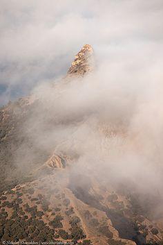 Rocky top of mountain above clouds by nickolay_khoroshkov, via Flickr